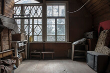 An Old Room In An Abandoned House. TV And Old Boxes With Things. Big Window. Wooden Walls And Floor. Translation Of The Inscription On The Boxes - Furniture Inside.