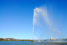 The Captain Cook Memorial Water Fountain Creating A Rainbow From The Water Mist On Lake Burley Griffin, Canberra, Australia.