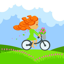 Little Girl Cartoon Character Riding A Bicycle. Vector Illustration Of A Person In Profile With Red Hair In A Green Dress With A Bouquet Of Pink Tulips On A Background Of Blue Sky And Flowering Meadow