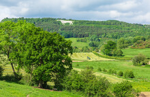 Haymaking In The Rural, Picturesque Village Of Kilburn, Near Thirsk In North Yorkshire With The Landmark Hill Figure Of The White Horse Of Kilburn In The Distance. Horizontal.  Space For Copy.