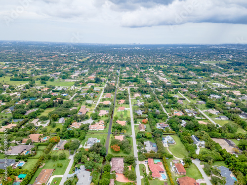 Fototapeta aerial drone of suburbs and city with highway