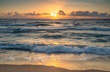 USA, Florida, Boca Raton, Sea Waves And Clouds At Sunrise