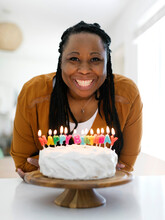 Smiling Woman With Birthday Cake