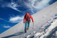 Switzerland, Canton Bern, Jungfrau, Climber Ascending Snowy Mountain