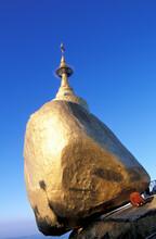 Myanmar, Mon State, Kyaiktiyo, Buddhist Monk Praying At Kyaiktiyo Pagoda Built On Top Of Granite Boulder