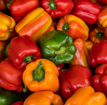 Group Of Multi-colored Bell Peppers At A Farmer's Market.