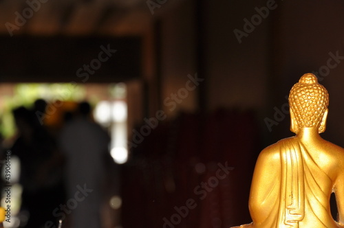 Canvas Print Golden buddha statue with bokeh background