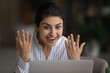 Leinwandbild Motiv Amazing. Astonished young mixed race lady show emotional reaction on great news on laptop screen celebrate winning auction job contest. Euphoric teen hindu female receive money prize at online lottery