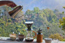 Many Cups Of Coffee On Mountian Background