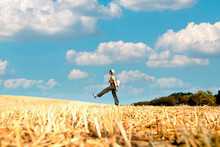 Traveler Woman With Backpack Walking On A Wheat Field At Summer - Travel Concept With Young Person Outside On Vacation