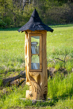 The Carved Library From A Tree With Books For Public Standing On A Meadow, Czechia.