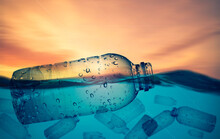 Plastic Bottles Float In The Sea. Plastic Waste Floats In The Water. Plastic Waste Change Your Life Concept