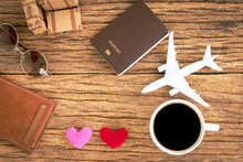 Coffee And Airplane Models And Hearts With Love And Passport And Luggage, Planning A Holiday Trip For Couples.