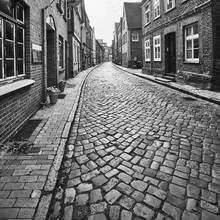 Cobbled Streets And Brick Houses In The Historic Old Town Of Lauenburg In Germany, Black And White