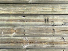 Vintage Aged Weathered Old Barn Farm Wood Building Wall Facade With Rusty Nails And Knots