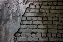Wet Brick Wall And Crumbling Cement Plaster.