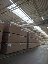 Warehouse Of Wooden Boards, Background Texture Of Wood Harvested For Shipment To The Factory, Finished Products Of The Woodworking Industry.