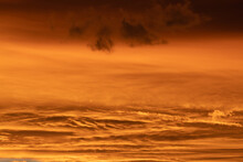 Sunset With Orange Clouds In Different Shades In The Sky