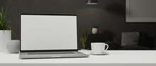 Laptop With Mock-up Screen On White Table With A Cup And Decorations, 3D Rendering