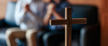 Close Up Cross Is Blur Background. Asian Christian Woman And Man Holding Hands In Praying For Jesus' Blessings To Show Love And Confession Of Their Sins According. Concept Giving Love Faith..