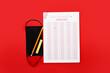 Leinwandbild Motiv Answer sheet, mask and stationery on color background
