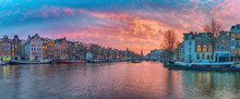 Amsterdam Netherlands, Sunset Panorama City Skyline Of Dutch House At Canal Waterfront