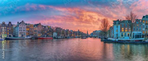 Fotografie, Obraz Amsterdam Netherlands, sunset panorama city skyline of Dutch house at canal wate