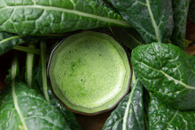 Fresh Organic Green Kale Leaves Pattern On A White Background, Flat Lay Healthy Nutrition Concept,Tasty Kale Smoothie