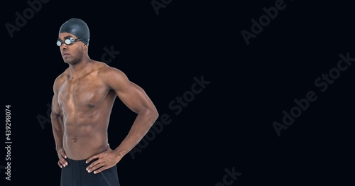 Composition of male swimmer with copy space isolated on black background