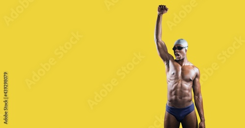 Composition of male swimmer with copy space isolated on yellow background