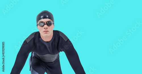 Composition of male swimmer with copy space isolated on blue background