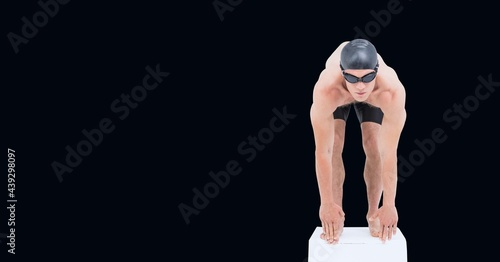 Composition of male swimmer on starting block with copy space isolated on black background