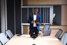 African American Businessman Using Digital Tablet In Meeting Room At Office