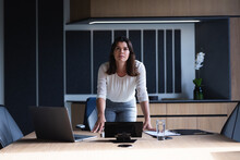 Portrait Of Caucasian Businesswoman Standing In Meeting Room At Modern Office