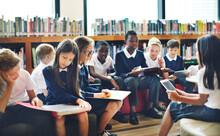 Diverse Students Wearing Uniforms In School