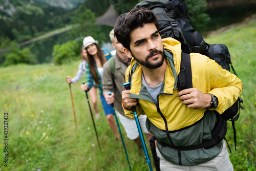 Group of happy hiker friends trekking as part of healthy lifestyle outdoors acti Fototapet