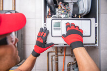 Gas Heater Repairing Performed By Caucasian Technician