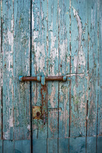 Old And Rusty Bolt And Lock On Exterior Door With Blue Paint