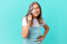 Middle Age Pretty Woman With A Magnifying Glass. Search Concept
