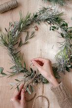 Making A Christmas Wreath With Branches And Leaves
