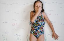 Girl Pretending To Swim On Drawn Sea