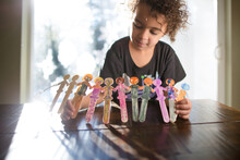 Child Shows Off Decorated Popsicle Stick Dancers