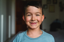 Portrait Of A Happy Young Boy At Home