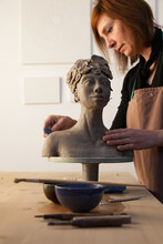 Artist Finishing A Clay Statue