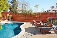 Swimming Pool And Furniture In Backyard