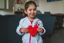 Little Girl Showing A Red Heart