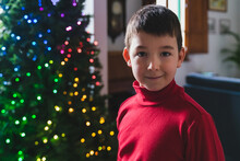Young Boy Portrait With Christmas Tree