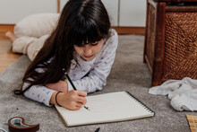 Little Kid Drawing At Home
