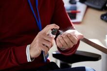 Businessman Using Hand Sanitizer