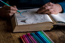 Woman Is Colouring In Her Sketchbook